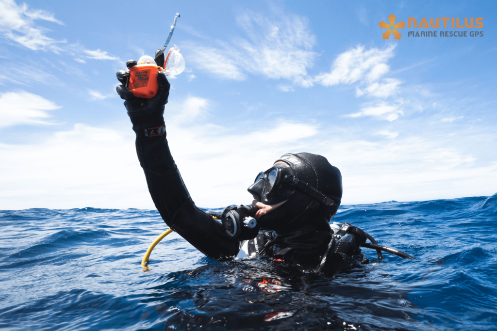 Scuba diver at the surface holding up a Marine Rescue GPS locator