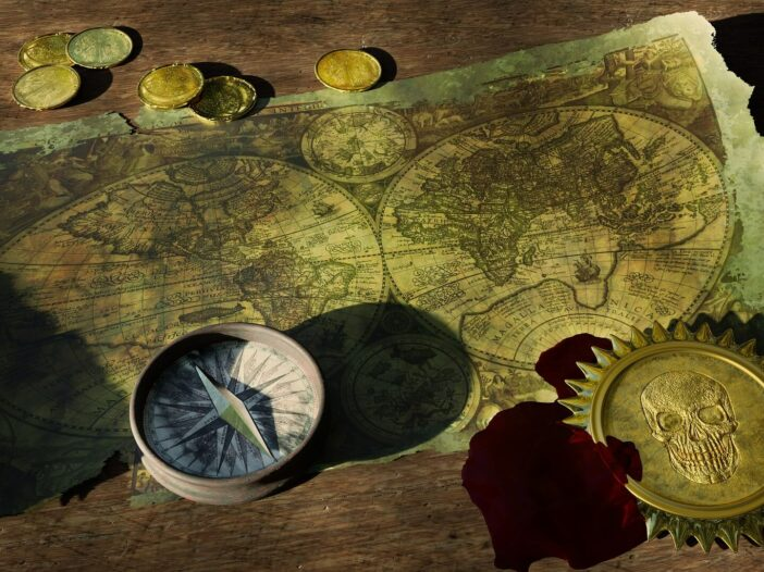 Aged treasure map with compass and gold coins