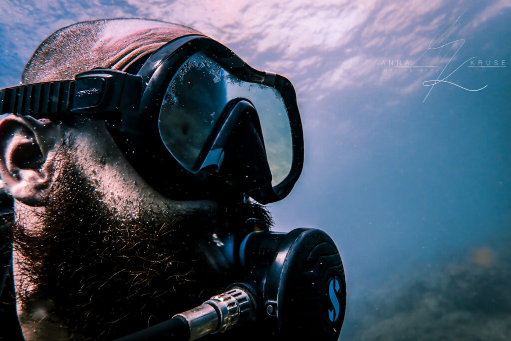 Bearded diver with a Scuba Pro regulator and reflective mask