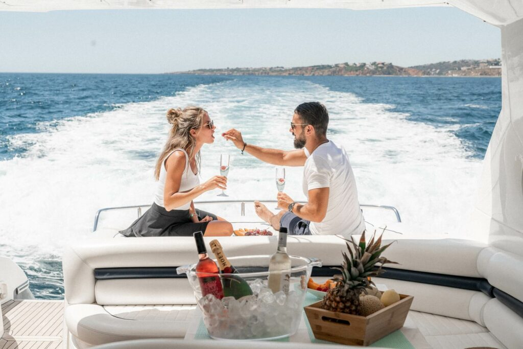 A couple dining on the back of a chartered sailboat