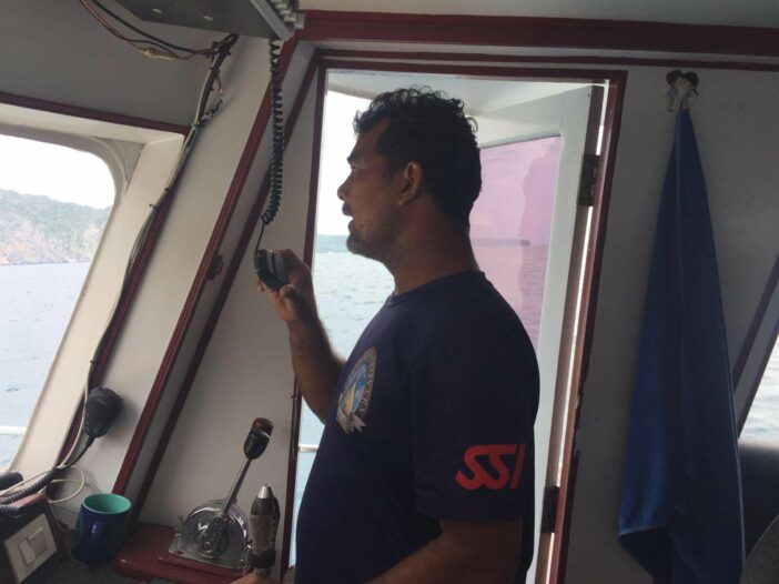 Boat captain issuing a mayday call at sea