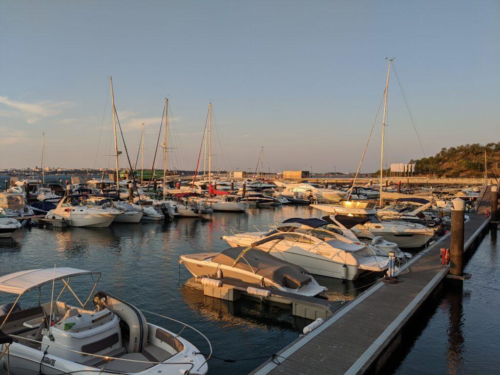 Boats docked at a marina at sunset