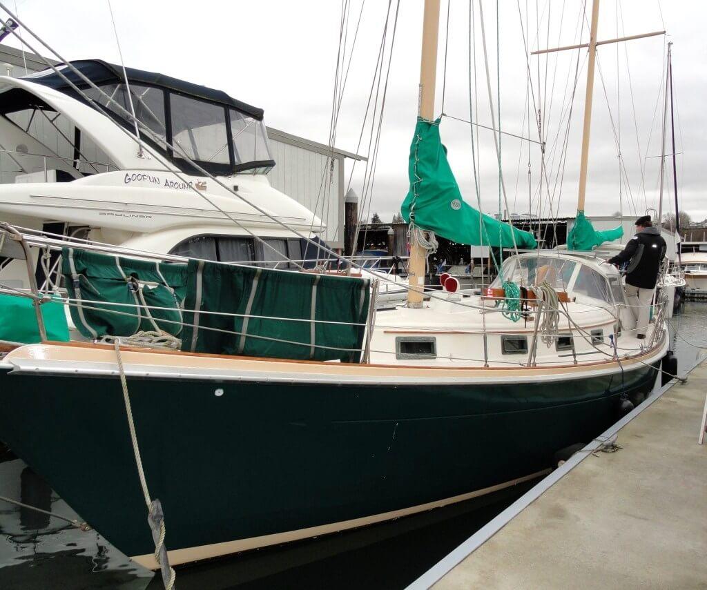 Green Allied Princess 36 sailboat at a marina