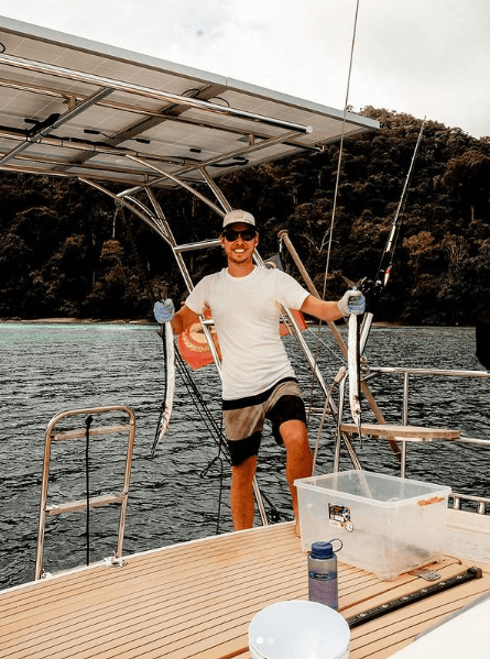 Chris Likins holding needle-fish caught in Thailand