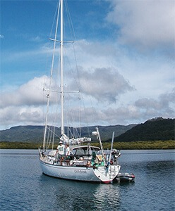 Peterson 44 sailboat with a mountain backdrop