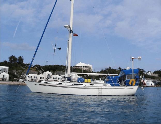 Passport 40 sailboat anchored near shore