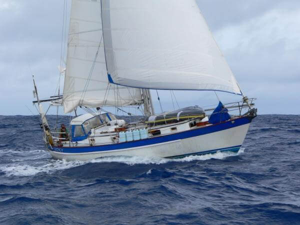 Valiant 40 cruiser with white sails designed by Robert Perry