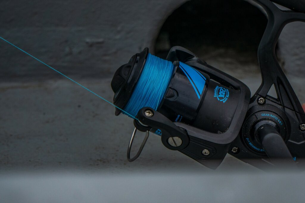 Spinning rod and reel with blue fishing line
