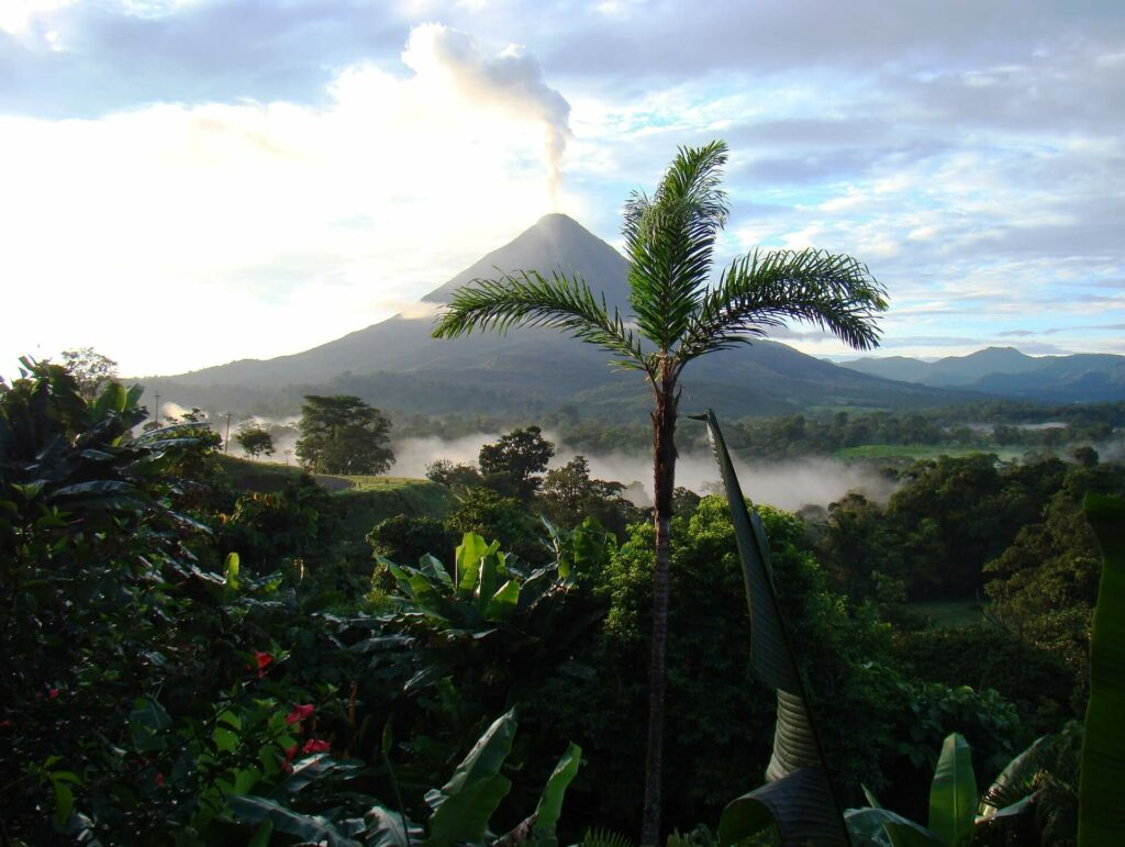 A volcano sits above the rainforest in Costa Rica