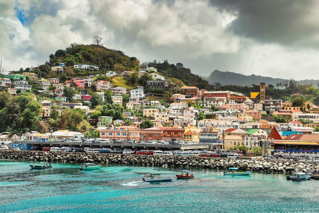 A colorful hillside town near the ocean in Grenada.
