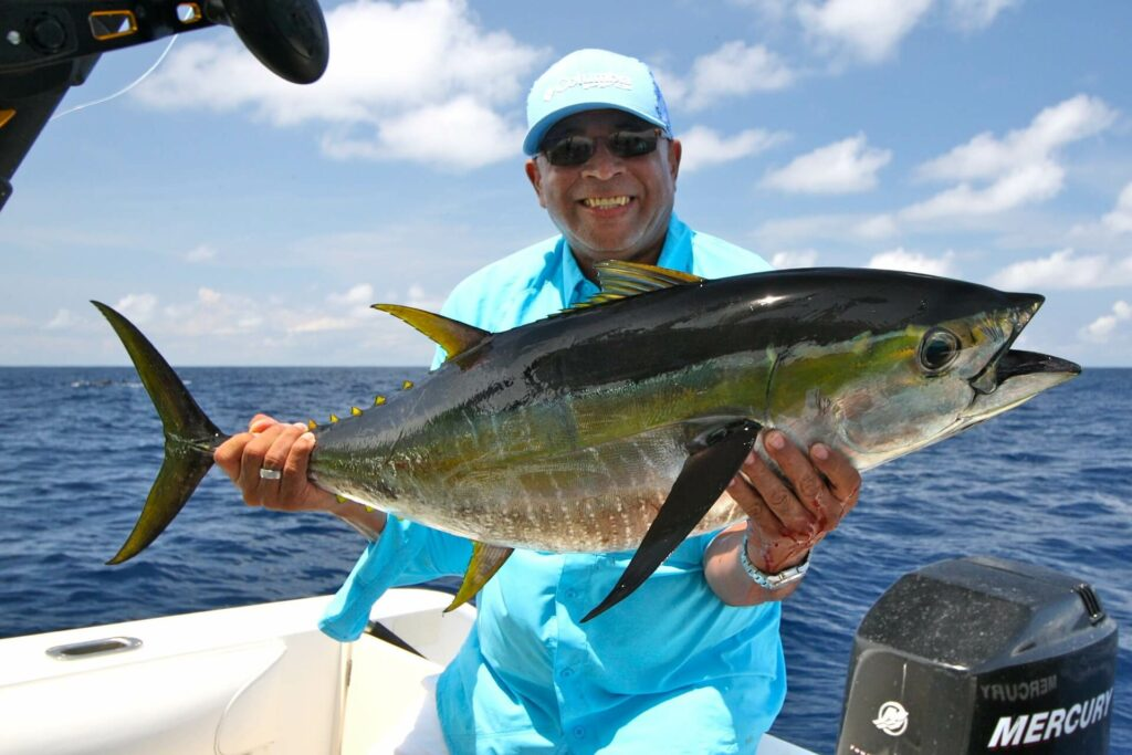 A man catches a yellowfin tuna while fishing in Nicaragua