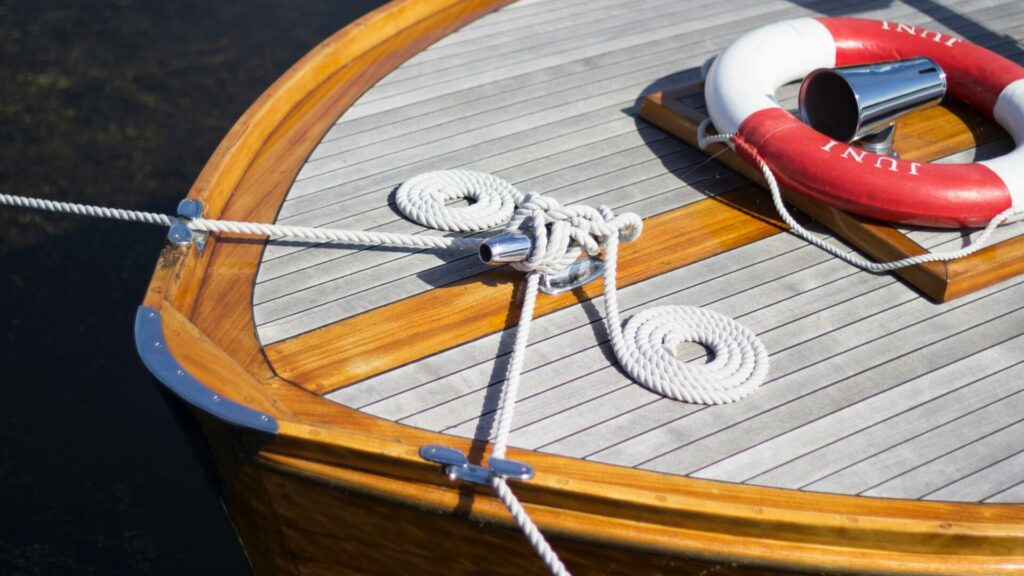 sailboat tied to a dock with a rope at the bow
