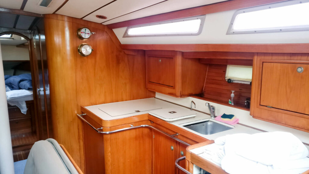 Wooden boat galley with kitchen sink