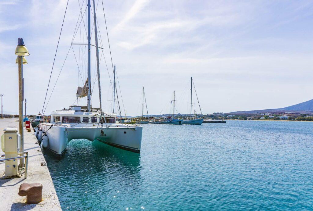 White catamaran sailboat docked on a sunny day