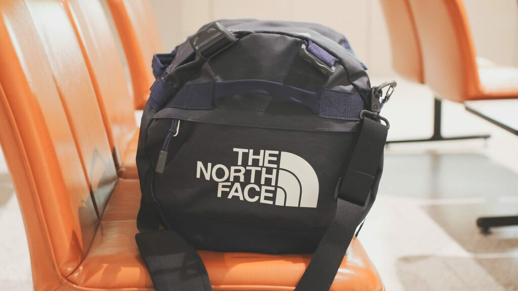A North Face duffel bag packed for a sailing holiday