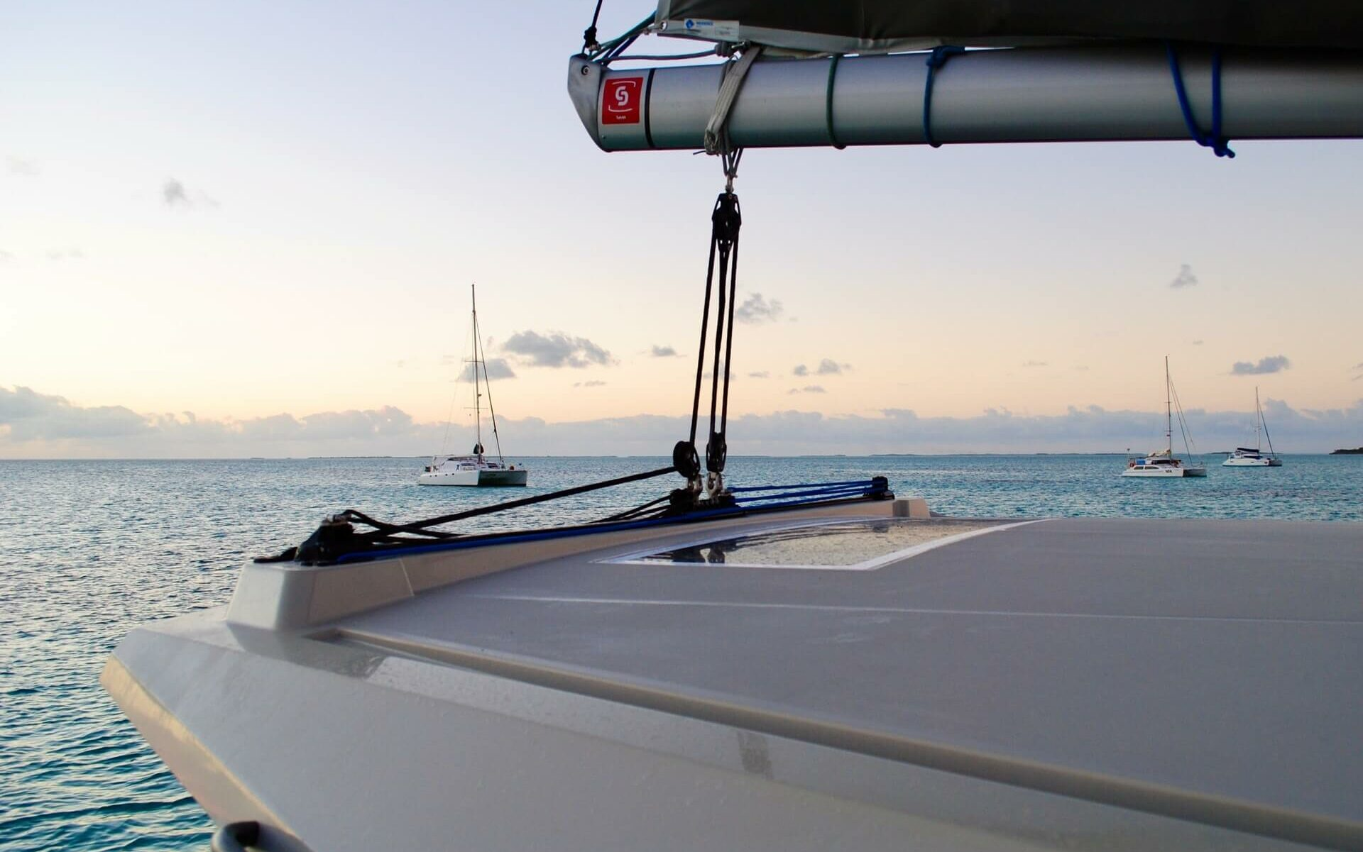 White sailboats at anchor in the Bahamas