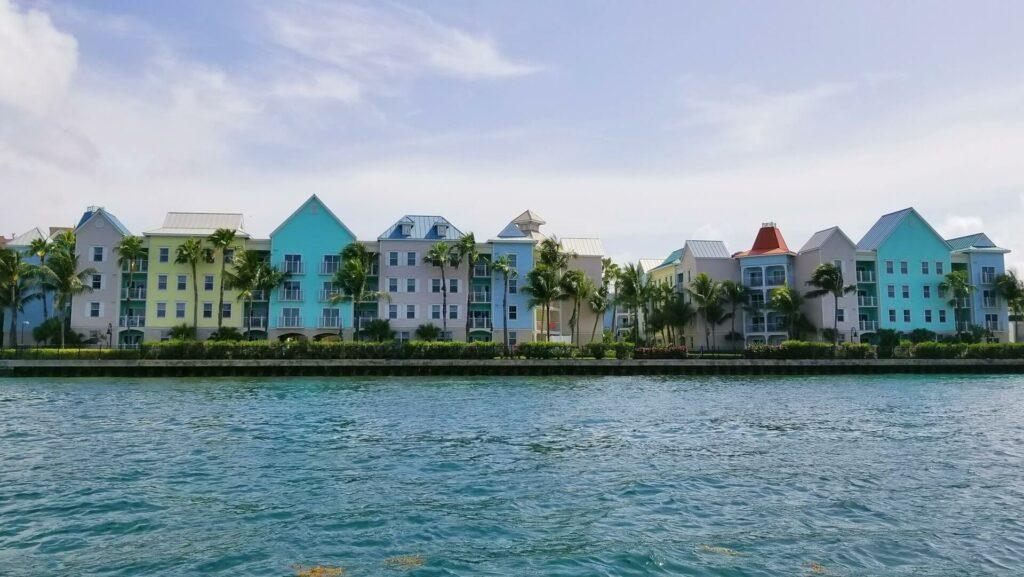 Colorful pastel buildings line the coast of Nassau