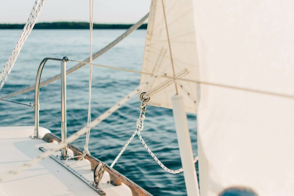 Fresh new white sails recently restored after a thorough boat restoration project