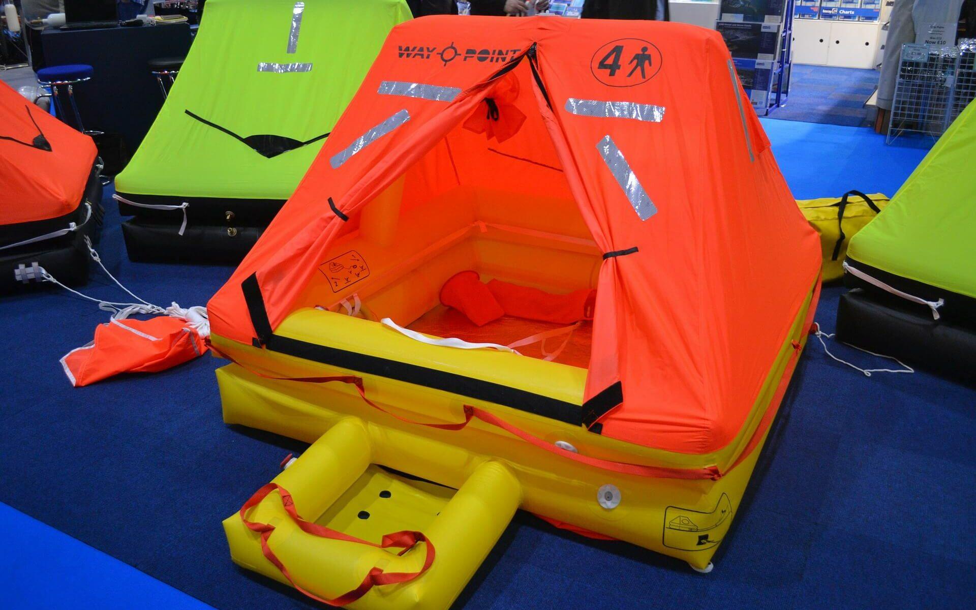 Orange and yellow emergency life raft used for sailing around the world